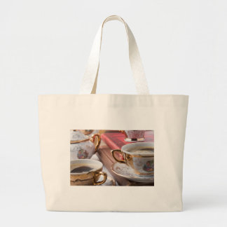 Vintage coffee cups with hot espresso and retro large tote bag