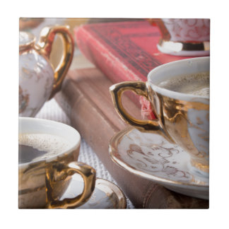 Vintage coffee cups with hot espresso and retro tile