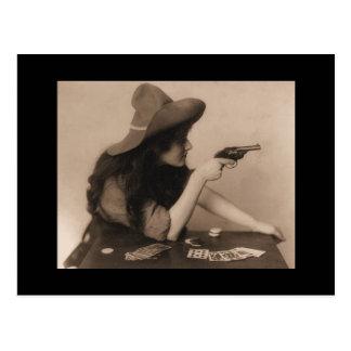 Vintage cowgirl with gun postcard