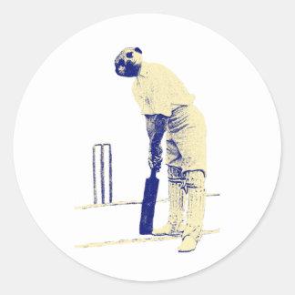 vintage cricketing meerkat. round sticker