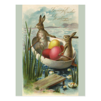 Vintage Easter Bunnies in a Boat with Easter Eggs Postcard