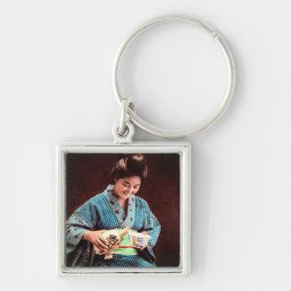 Vintage Geisha Imbibing in a Cup of Sake old Japan Key Ring