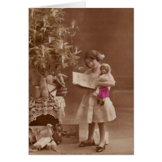 vintage girl with doll at christmas card
