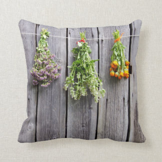 Vintage grey wall drying herbals hanging down pillows