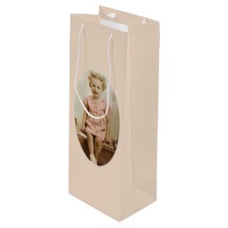Vintage little blonde girl in pink dress wine bag