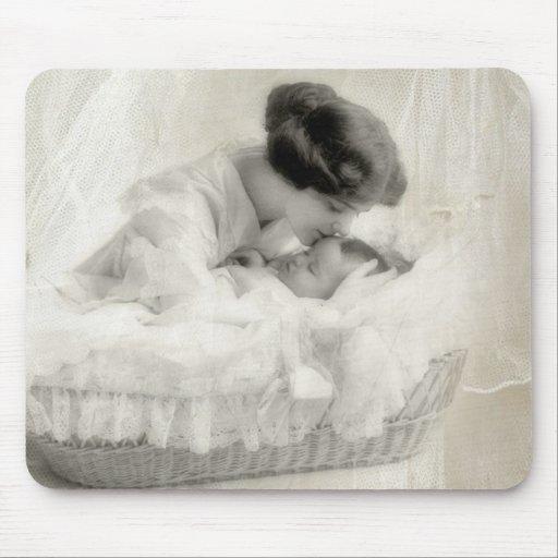 Vintage Mother Kissing Baby in Bassinet
