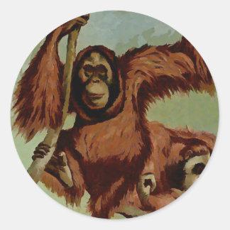 Vintage orangutans on a tree classic round sticker
