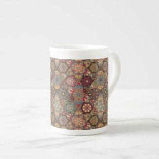 Vintage patchwork with floral mandala elements tea cup