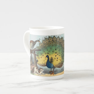Vintage peacocks and a cat tea cup