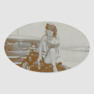 VINTAGE PINUP GIRL ON MOTOCYCLE. OVAL STICKER