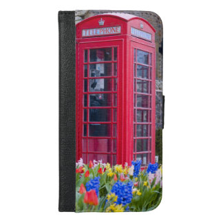 Vintage Red Phone Booth with Garden Flowers