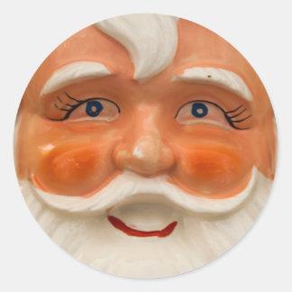 Vintage santa face classic round sticker