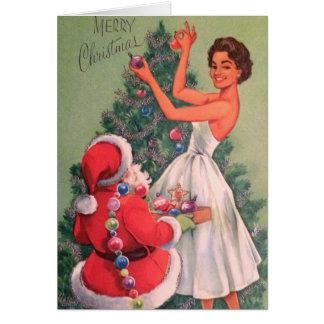 Vintage Santa Helps Woman Decorate Tree Card