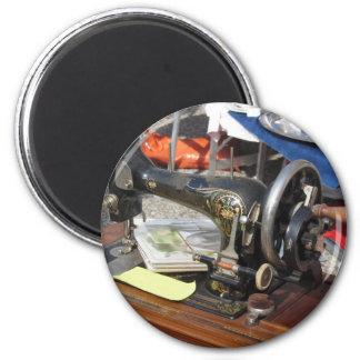 Vintage sewing machine at flea market magnet
