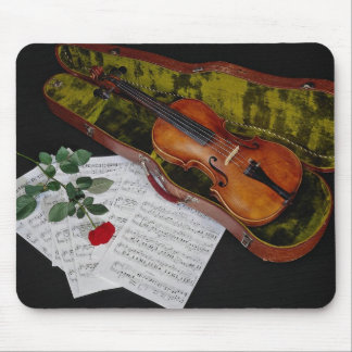 Violin and red rose on black background mouse pads
