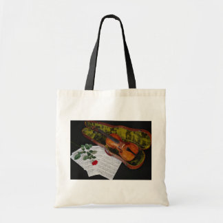 Violin and red rose on black background budget tote bag