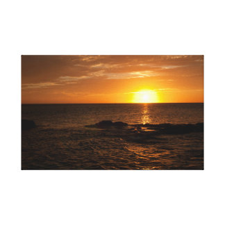 Vivid sunset over the ocean stretched canvas print
