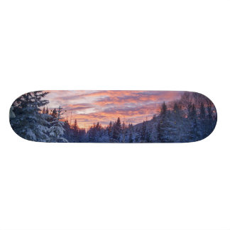 Vivid sunset paints the sky above wintery skate board deck
