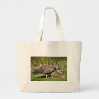 Vulture on grass large tote bag