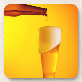 Waiter pouring beer, glass of a cold drink beverage coasters