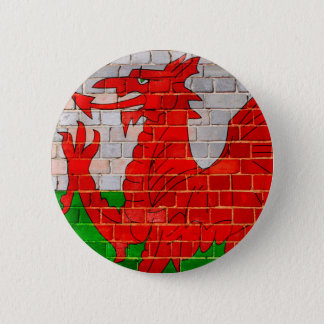 Wales flag on a brick wall 6 cm round badge