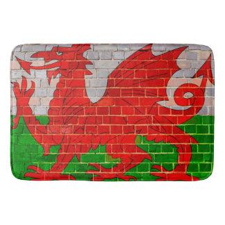 Wales flag on a brick wall bath mat