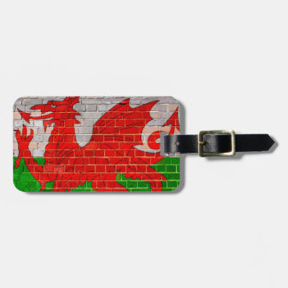 Wales flag on a brick wall luggage tag