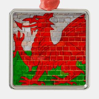 Wales flag on a brick wall metal ornament