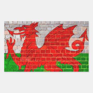 Wales flag on a brick wall rectangular sticker