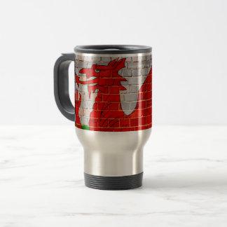Wales flag on a brick wall travel mug