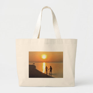 Walking on the beach large tote bag