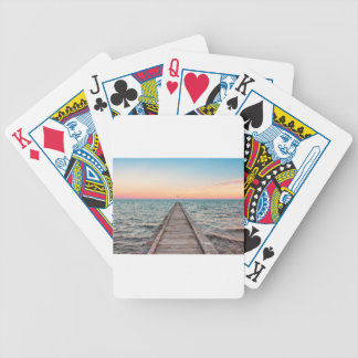 Walking towards the infinity of the sea bicycle playing cards