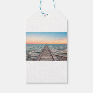 Walking towards the infinity of the sea gift tags