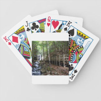 walkway near stream bicycle playing cards
