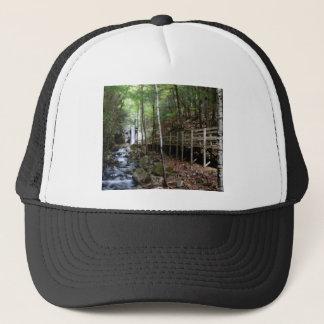 walkway near stream trucker hat