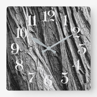 wall clock trunk of tree with white numbers