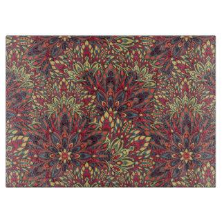 Warm color mandala pattern. cutting board