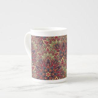Warm color mandala pattern. tea cup