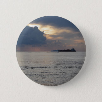 Warm sea sunset with cargo ship and a small boat 6 cm round badge
