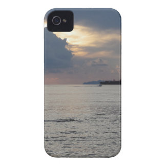 Warm sea sunset with cargo ship and a small boat iPhone 4 case