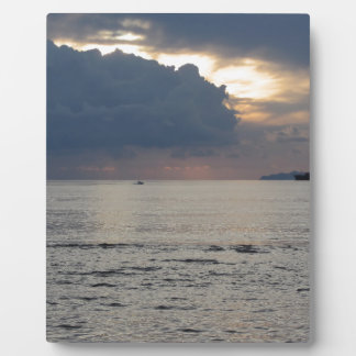 Warm sea sunset with cargo ship and a small boat photo plaque