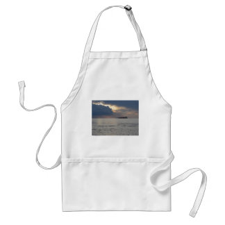 Warm sea sunset with cargo ship and a small boat standard apron