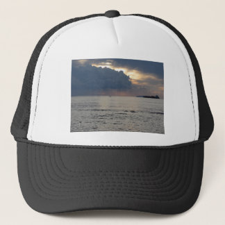 Warm sea sunset with cargo ship and a small boat trucker hat