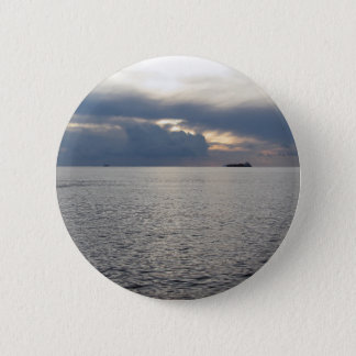 Warm sea sunset with cargo ship at the horizon 6 cm round badge
