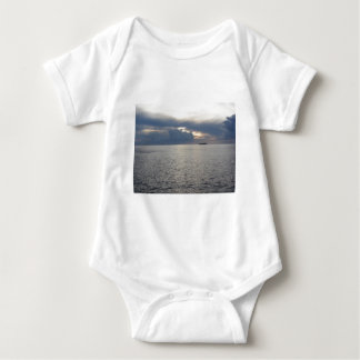Warm sea sunset with cargo ship at the horizon baby bodysuit