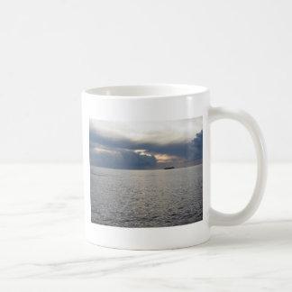 Warm sea sunset with cargo ship at the horizon coffee mug