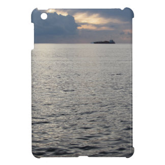Warm sea sunset with cargo ship at the horizon iPad mini cases