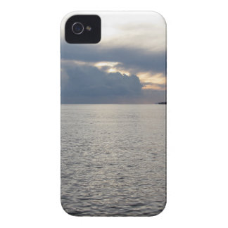 Warm sea sunset with cargo ship at the horizon iPhone 4 cover