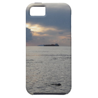Warm sea sunset with cargo ship at the horizon iPhone 5 covers