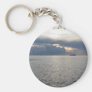 Warm sea sunset with cargo ship at the horizon key ring